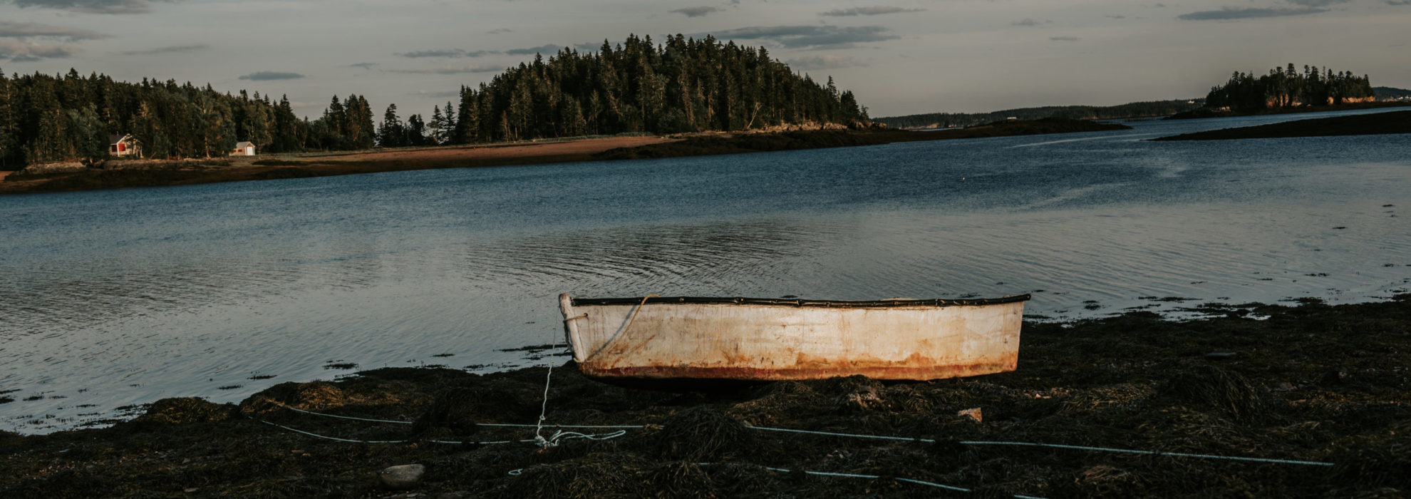 dingy on land at sunset